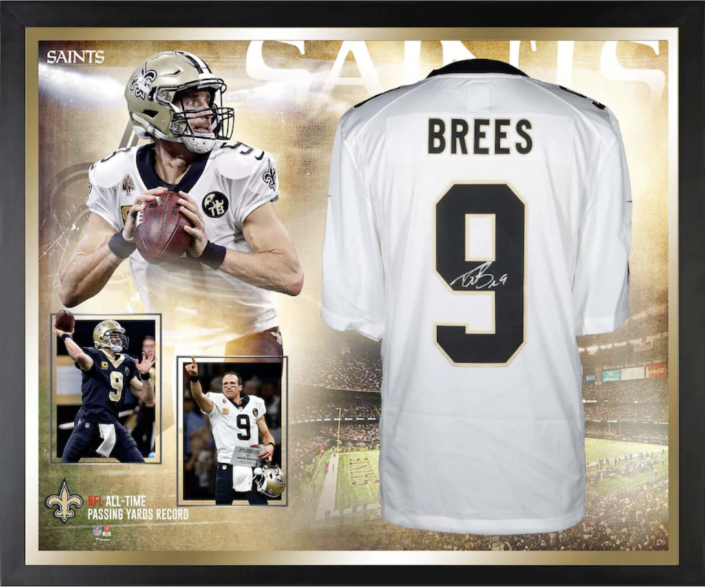 autographed Drew Brees Jersey in a display case