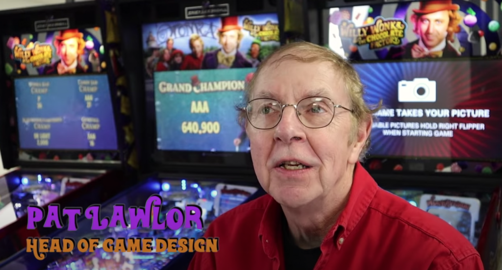 Pat Lawler - Head of Game Design at Jersey Jack Pinball in front of Willy Wonka pinball machines